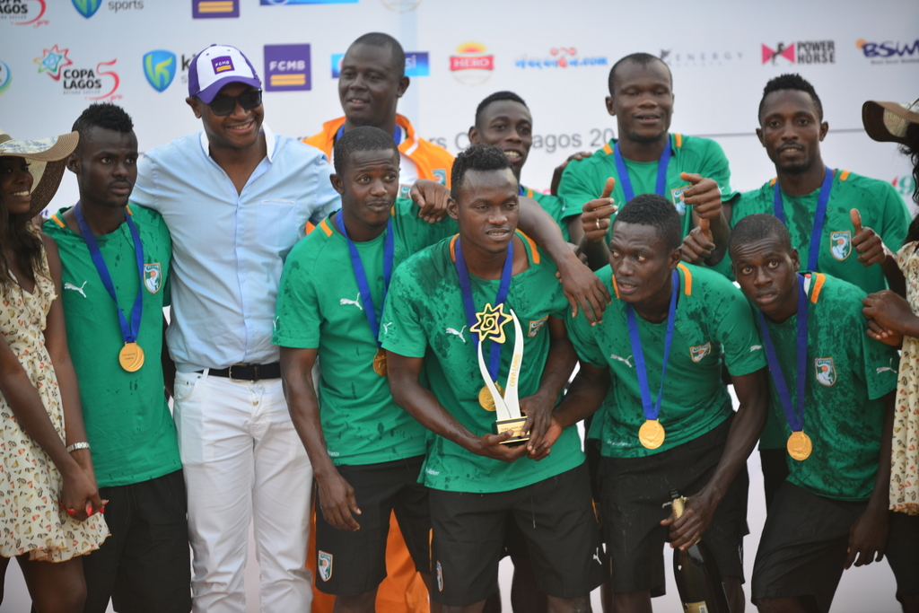 The CEO of First City Monument Bank (FCMB), Mr. Ladi Balogun, with the victorious beach soccer team of Cote D'ivoire during the finals of the COPA Lagos Beach Soccer tournament in Lagos on Sunday (December 20, 2015). The CEO of First City Monument Bank (FCMB), Mr. Ladi Balogun, with the victorious beach soccer team of Cote D'ivoire during the finals of the COPA Lagos Beach Soccer tournament in Lagos on Sunday (December 20, 2015).